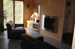 Chalet Les  Eaux Tortes - The louge area with built-in fire